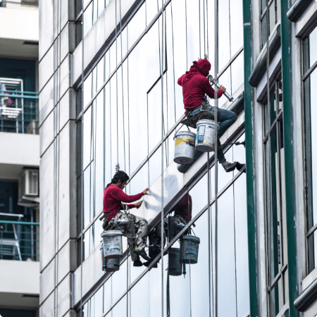 group-workers-cleaning-windows-service-high-rise-building